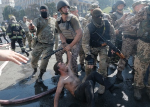 http://i.cbc.ca/1.2729868.1407409768!/cpImage/httpImage/image.jpg_gen/derivatives/original_300/ukraine.jpg  Special forces detain an activist during a clash in Kyiv's Independence Square on Thursday. (Efrem Lukatsky/Associated Press)